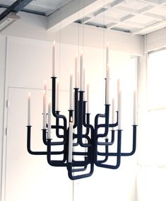 """A chandelier is iconic in lighting; it gives warmth and creates immediate atmosphere . The Rise of Flame is a gothic chandelier, a controlled contortion, created with the latest bending techniques. Gothic Chandelier, Candle Chandelier, All Of The Lights, Black Decor, White Walls, Lighting Design, Modern Design, Ceiling Lights, Candels"