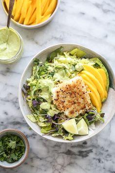 Quinoa-Crusted Fish Taco Bowls With Mango and Avocado Slaw | Feed Me Phoebe | #glutenfreerecipe #glutenfree #healthyrecipes