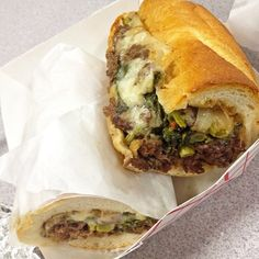 Steak, grilled onions, provolone, broccoli rabe on an Amarosa roll.