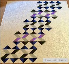 """Geometric Slide : Pattern by Faith Jones from the book """"Vintage Quilt Revival""""; fabric is various Bella Solids; pieced & quilted with Aurifil 50 wt #2600 Dove Grey"""