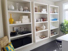 Floating book-case like shelves; could DIY with regular floating shelves and add side panels. From Pomona's Boutique-Style Space on Apartment Therapy