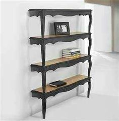 Turn that table into shelves to hang on the wall :)