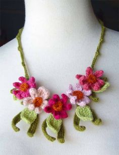 crocheted flower wonder if I made these if anyone would actually wear them