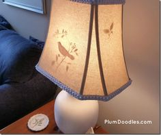 Tutorial for Peek-A-Boo Lamp shade:    http://www.plumdoodles.com/2012/08/14/diy-lamp-makeover-with-peek-a-boo-lamp-shade/