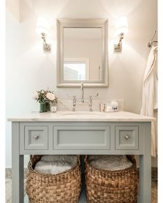 Fulham Garden Flat - We put in an extra bathroom with the extension. We designed this vanity unit which was custom made and added in large baskets to hold towels and linens. We love using wall lights in bathrooms to add some warmth and charm. #bath #bathroompic #bathtub #bathdesign #design #bathroom #bathdecor #bathroomdesign #bathfaucet #bathideas #bathinspiration #luxurybath #bathroomdecor #bathdesignideas #dreambath #dreambathroom by magnus_design