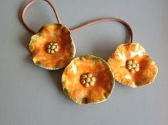 3 fleurs oranges