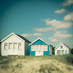 Beach huts - these look like you could sleep in them. Ahh drifting off and waking to the sound of the sea....magical