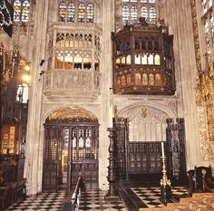 Katherine of Aragon's window in St George's Chapel.  To the right is a wooden oriel window in St George's Chapel, Windsor, that looks onto the Quire. Was originally built for Katherine of Aragon, whose pomegranate emblem is still present. This is where Katherine Parr sat and watched Henry VIII's funeral service and burial that occurred below.    To the left is a stone window that opens into the raised chapel of Edward IV's Chantry.