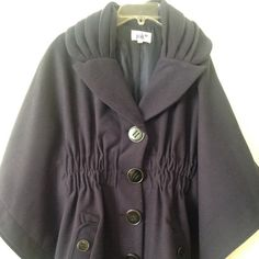 Dark blue coat. Fairly new. Supper cute. Other
