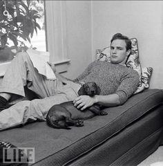 Marlon Brando with his wiener dog.