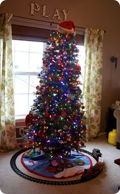 Love the santa hat as a tree-topper.  Why didn't I think of this??  Using this idea for Colt's bedroom tree next year.