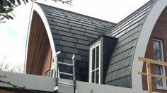 Zonnepanelen in de vorm van dakpannen | Zonnepaneelwijzer - wijzer in zonnepanelenZonnepaneelwijzer - wijzer in zonnepanelen