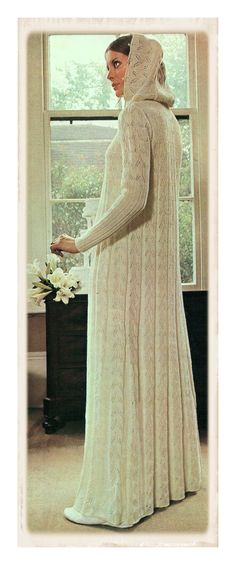 A SCANNED and REFORMATTED COPY OF A VINTAGE 1970s ENGLISH KNITTING PATTERN  to make a stunning  Ankle Length Lace Wedding Coat  Finished length shown is 58 inches..  Long sleeves with a snug wide rib pattern from wrist to the elbow Gorgeous Lace panels..Full flared shape Mandarin Collar neckline with an optional Cowl Hood Fastened all up the front with tiny pearl buttons.. Pearl buttons trim the hood.. Finished with a picot crochet edging  *WEDDING GLAMOUR*  Requires a 4 Ply/ sport weigh...
