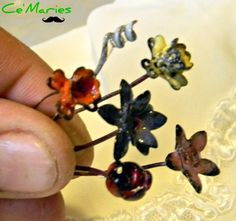 6 Torch Fired Enameled Flower Head Pins/Bouquet is going up for auction at  8am Wed, May 15 with a starting bid of $6.