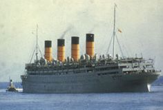 1946: Aquitania in her twilight years, sporting her wartime grey with traditional Cunard funnels.