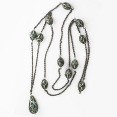 Long sterling silver bead chain with rare inlaid turquoise and silver beads, imported from India circa 1930s. The beads are 15x9mm and the center teardrop is 23x12mm.  Necklace length is 36