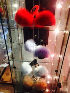 A beautiful display cabinet,show casing some of our unique combinations of fOOfOO Slippers . The fOOfOOs shown are fluffy-heeled slippers with various coloured sheepskin uppers and mule bases. Every nuance of the shape and contours of the woman's foot must be taken into account if the handmade shoe is to fit correctly. Our designs are the result of a long process of consultation between our clients so that we are now able to bring to the world exquisitely crafted women's quality slippers.