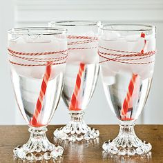 ☆ Candy Cane Gimlets using peppermint Schnapps and Sprite with peppermint candy stir sticks