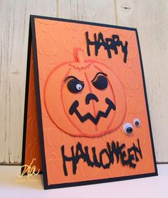 handmade card:Happy Halloween by kiagc  .. orange and black ... luv the die cut jack-o-lantern and spooky lettered sentiment  embossing folder pumpkins background ..