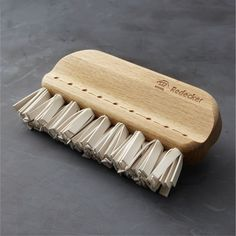 Redecker® Rubber Upholstery Brush - $29.95 at Crate and Barrel (clean off the dog hair?)