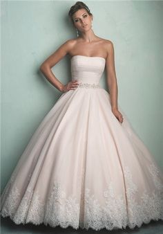 Sometimes a beautiful thing done simply is simply the best. This English net ballgown is ruched softly at the bodice and features a Swarovski crystal waistband and hem lace, and it is absolutely lovely.