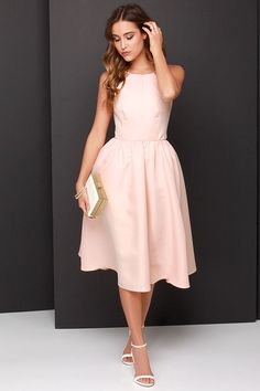 Aunt Re, you should probably buy this! $58.00   Lead a Charmed Life Peach Midi Dress at Lulus.com!
