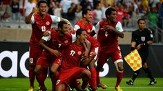 BELO HORIZONTE, BRAZIL - JUNE 17: Jonathan Tehau of Tahiti celebrates with his team-mates after scoring his team's first goal during the FIFA Confederations Cup Brazil 2013 Group B match between Tahiti and Nigeria at Governador Magalhaes Pinto Estadio Mineirao on June 17, 2013 in Belo Horizonte, Brazil. (Photo by Laurence Griffiths/Getty Images)