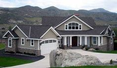 Dramatic Craftsman House Plan - 23252JD | Craftsman, Northwest, Photo Gallery, 1st Floor Master Suite, Butler Walk-in Pantry, CAD Available, PDF, Sloping Lot | Architectural Designs