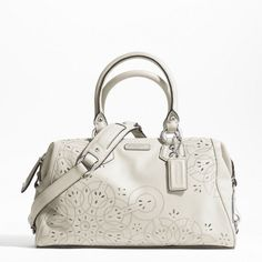 Coach Ashley tossed laser cut satchel.    I finally settled on this one! It is gorgeous!
