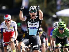 Mark Cavendish celebrates while crossing the finish line to win Stage 7 of the 2015 Tour de France between Livarot and Fougeres.  Sebastien Nogier, EPA