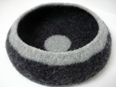 this small cat (or very small dog) bed was hand crocheted and knit with a wool and mohair blend, then felted for strength.