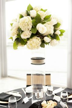 Black and Gold Wedding Reception. Tall Centerpieces of White Roses and Hydrangeas by Humphrey's Flowers in Chattanooga, TN