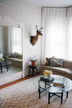 Antlers on the wall - Chicago 2 bed apartment. Fall decor & design trends. #antlers #decor #home