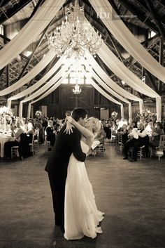 the chandelier with the leading lines of the drapes ... perfect pic - totally focusing on bride and groom!  LOVEEEE!:)
