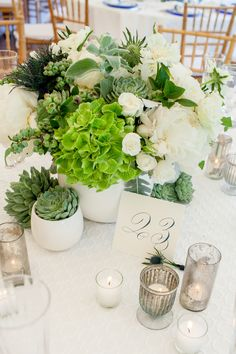 Great center pieces using succulent thistle hydrangea peony roses Hyperion berries and greenery