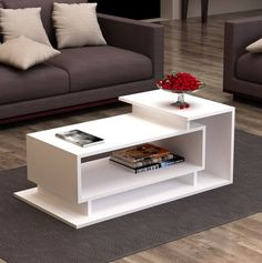 Table Basse Colindas Modern living room style is easy to create with this Colindas Coffee Table! It features a simple, asymmetric design and three shelves. You'll love having your favorite books, magazines or media items easily accessible. Tv Unit Furniture, Home Decor Furniture, Table Furniture, Living Room Furniture, Furniture Design, Furniture Outlet, Unique Furniture, Discount Furniture, Luxury Furniture