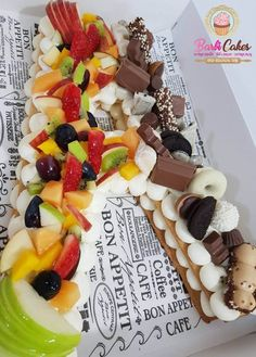 Fruit Biscuit Tart Layered Cake (Recipe + Tutorial)   The latest craze that is inspiring the caking world is these fruit tart, biscuit, cake layered number or letters 'cakes' decorated with cream, fresh seasoned fruit and sometimes chocolate.