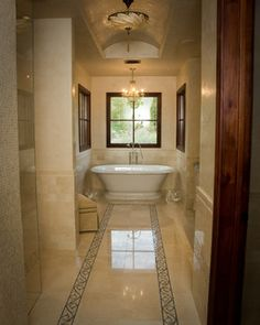 Elegant Master Bathroom in a Golden Tan, Travertine or Marble floor and walls
