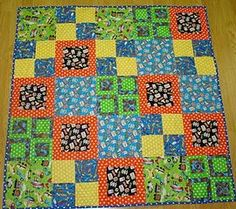 Simply Squares Baby Quilt (FREE pattern) ~ Easy baby quilt patterns can be more than just squares in a row! This quilt brings the simplicity of square piecing into a pattern with plenty of interest and variation. Make these squares in primary-colored prints for baby boy quilts. Even though you're using a basic shape, this simple baby quilt is far from boring. Make a variety of blocky designs that can look retro, modern, and much more depending on your fabric choices.