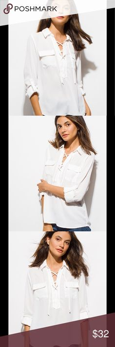 White chiffon laceup boho blouse A wardrobe essential, the white chiffon laceup quarter sleeve boho blouse. Laceup collared neckline, and flap pockets on either side. 100% polyester. Tops Blouses