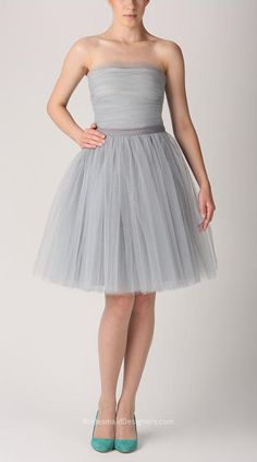 Strapless knee length cocktail dress simply made from grey tulle. Layered short skirt, side zip, matching with simple sash