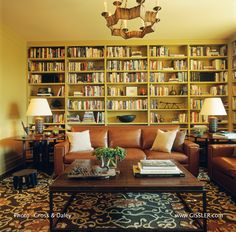 This Library and TV room is in a large Central Park West apartment for a family with four children. In anticipation of very heavy use by the children, their friends and a lot of pets, the sofas are upholstered in leather, and the custom Martin Patrick Evan area rug was designed to have a bold all-over pattern to hide a 'myriad of sins'.  www.GISSLER.com
