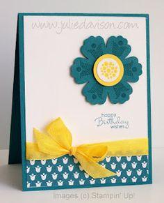 """Summer Smooches Blossom Card   Keywords: SUO CAS Stampin Up! Summer Smooches Biright Blossoms,    Stamps: Bright Blossoms, Petite Paris    Paper: Island Indigo, Whisper White    Ink: Island Indigo, Daffodil Delight ink    Accessories: Summer Smooches DSP, Blossom Punch, 1"""" Circle Punch, Daffodil Delight Seam Binding"""
