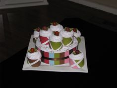 Wedding Cake - Made from 4 tea towels and 8 dish clothes, a cake platter and some lollipops and craft paper.