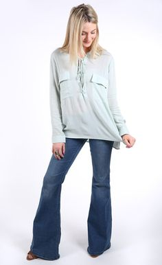 Make bold boho waves in this flowy, lace-up number. Comfy + casual for extra style points. Details: Lightweight, sheer material Features two front pockets, la