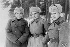 Three well insulated Soviet officers pose for a group portrait in the woods near Indents, Tver Region, Central Front, 1942. From right to left, Lt Col Nikitin, senior battalion political commissar Al Ganzburg, and Major Votolovsky, 246th Infantry Division.