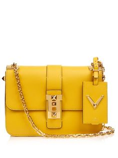Valentino's B-Rockstud bag is refreshed in a summer-perfect mustard-yellow shade. Gold-tone metal hardware accents the front flap, while the interior holds multiple pockets and compartments for optimum organisation. Wear it over the arm, shoulder or body using the metal chain strap.   Available at MATCHESFASHION.COM