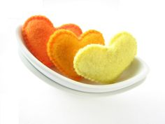 Bright orange, orange and lemon felt Valentine's hearts (high quality). $6.00, via Etsy.