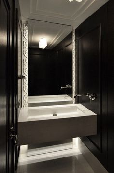 Neil & Jackie styled one of their bathrooms with quite dark interiors.  Here's another idea of how you van design your bathroom with dark colours, but still make it seem really inviting and chic