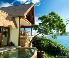 """Royal Davui Island Resort, Fiji.  """"Accessible only by boat or helicopter, this South Pacific island resort guarantees some coveted alone time—and in a paradise-like setting. Consider your accommodations: 16 thatched-roof villas, each hidden by dense plant life and equipped with a private plunge pool overlooking Beqa Lagoon; an outdoor shower; and stretches of white-sand beach. Venture out for champagne breakfasts on a deserted sandbar and diving with dolphins and turtles."""" $1000/couple/night"""